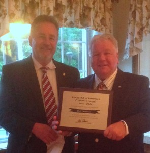 President Andy Steeves (L) presents Chris with the President's award for 2013-2014